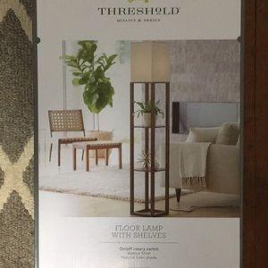 Threshold floor lamp with shelves